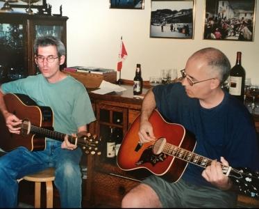 steve-playing-hummingbird-guitar-e1525635503265.jpg